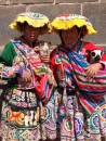 Bright and colorful traditional clothing - different hat designs represent local areas