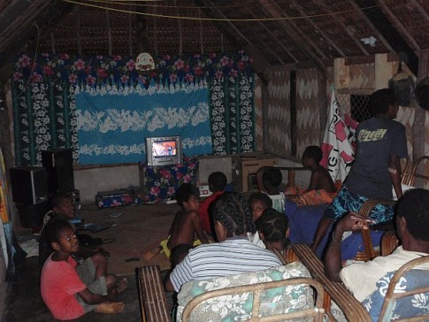 Inside of the hut where we had our roast dinner.  The whole neighborhood was there watching a music video while the generator was running.