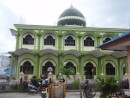 A traditional Indonesian Mosque that has 8 speakers circling the bottom of the dome calling the faithful to worship 5 times a day.  Unfortunately the unfaithful are also able to hear the broadcast, especially the 3 AM prayer!.