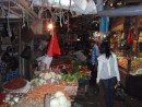 The morning market was packed with strange vegetables and fruits and hundreds of Indonesians.