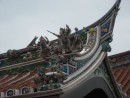 This colorful roof is protected by fierce warriors.