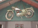 Not only is this an authentic motorcycle from WWII, but there is a sign on the wall beneath cautioning soldiers that a life will be lost if you fall asleep on duty.