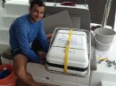 Axel installing the Ocean Safety life raft. This is an ISO Ocean series and one we hope never to use!