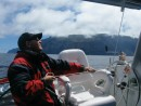 Steve trims a sail while passing Guadelupe Island