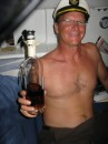 The captain passes around the rum as we cross the equator.
