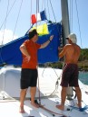 Kurt and I raising the yellow quarantine flag and the french courtesy flag.