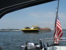 Barge and pusher tug passing us in the busy Norfolk harbor