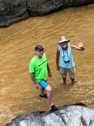 Eric and Kirk wading in the shallow-end of the natural pool at the Quimixto waterfalls.
