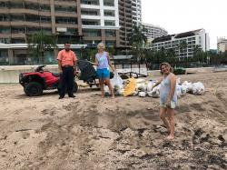 Big THANKS to the Grand Venetian maintenance staff who brought their ATV and trailer to pick up the large bags of trash. We filled four extra-large (body bag sized) black garbage bags with plastic and styrofoam trash. Hopefully, we prevented a few sea birds, turtles, dolphins, or whales from eating plastic.