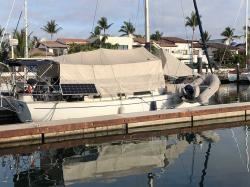 Due West in her normal summer mode with sunshade up. But when a hurricane is forecast, the sunshade quickly pulls back and ties up along the bimini frame (see next photo.)