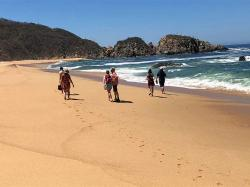 Giant beaches with big waves to play in at Playa Mayto.
