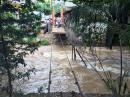 "The 7-15"" of rain that Pilar brought with her washed out this hanging bridge in Old Town PV that we used to walk across daily. Hoping it"
