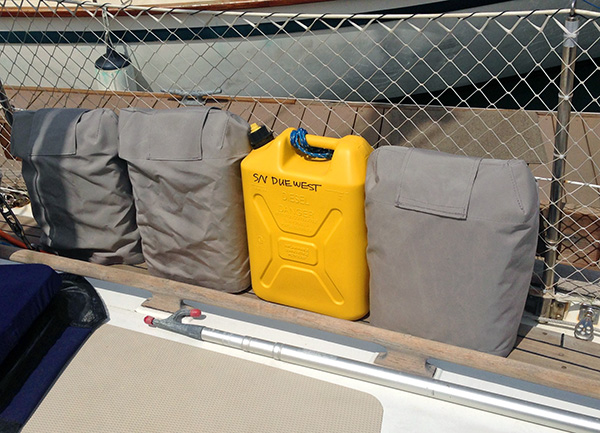 "Our canvas jerry can covers help protect the plastic from sun, and the fuel from heat. We have 2"" x 6"" lashing boards on each side of the foredeck to lash our jerry cans to while under way. We had the jerry can covers made with velcro handle covers, so that the whole can can be covered, or we can uncover the handle for carrying them with covers on."
