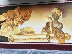 This interesting mural was on the outside wall of the tobacco store. We din