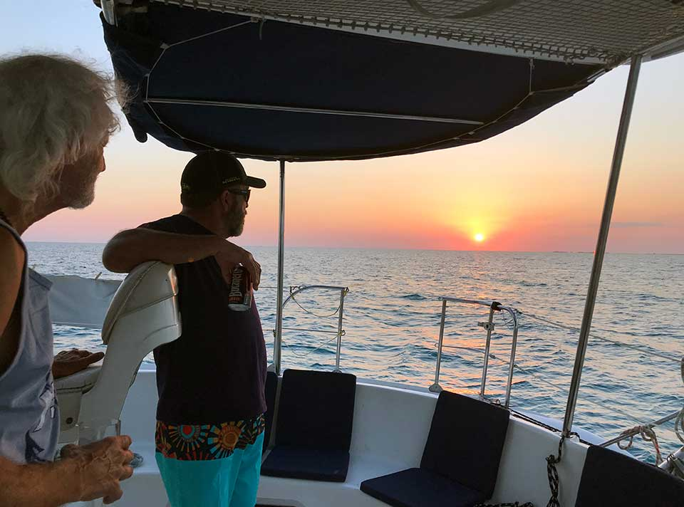 Kirk and Rob watching for the Green Flash which Rob had never seen, and was skeptical about… while we never saw it in Cuba, we HAVE seen it in Mexico and in Florida!