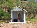 Another road-side shrine housing the Virgin of Guadeloupe, the patron saint of Mexico.