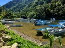 The hiking trail leaves from the head of the bay at Boca del Tomitlan, passing all these fishing pangas in the river...