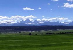"The ""other-side"" of the Tetons rising up above the farm fields in southeast Idaho."
