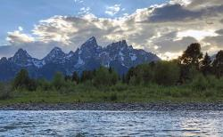 Spectacular view of the sunset over the Grand Tetons from the middle of the Snake River. THIS is why we prefer the evening float...