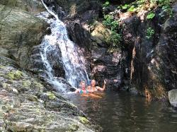 New friend Lisa and Heidi cooling off in this refreshing waterfall at Playa Colomitas, the one-quarter-way reward on this hot jungle hike. Three quarters still to go and no more waterfalls...but lots of beaches.