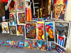 Street artists are everywhere selling colorful paintings depicting Ché, Cubanos, classic cars, and tropical scenes.
