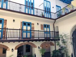 Courtyard view of typical Spanish Colonial merchant home: The ground floors were used as mercantiles and storage for food and other dry goods, easily transported by horse carts from the nearby wharfs. The second floors with balconies that overlooked the courtyard were merchant offices, accounting, etc. The top most third floor and rooftop terrace were where the merchants lived with their families.