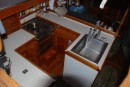 Galley after refit.  Custom woodwork and countertop by Jeff Logan.  Varnish and finish work by Jo