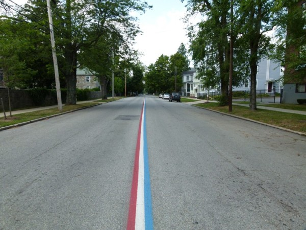 One of the places we stopped was Bristol, RI.  They have a red white and blue stripe going down the middle of the road to show the parade route. It