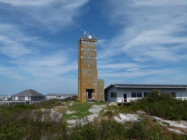 We took our dinghy over the Appledore Island.  It is the biggest island in the group.  Most of the island is owned by Cornell University and the University of New Hampshire.  This is a WWII spotting tower just like the ones we climbed in Maine but it has been converted to a research building.