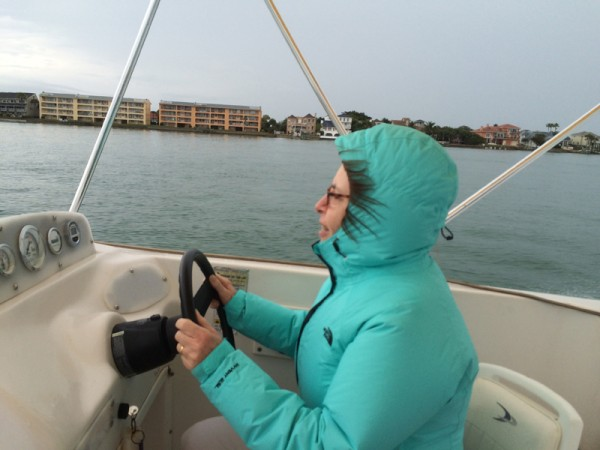 I even got a chance to drive the boat. Notice my hair streaming back while the boat was up on plane. We just drifted while we had lunch and were rewarded by a dolphin swimming around the boat!  When we got back to Pat
