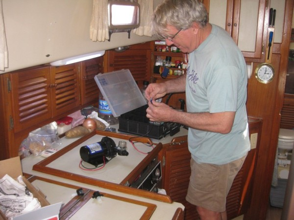 Guy also brought a new water pump, which made it possible for us to continue our trip. Otherwise we may have had to turn back to Florida, or wait for one to be shipped to us at a premium price. Here is Bill working on the new pump.