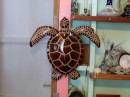 He also makes some incredible art works. This turtle is made out of wood, it