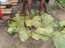 Removing the banana leaves