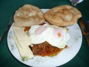 "Panamanian Breakfast--eggs over beef with onions & peppers, local cheese and ""fry bread"""