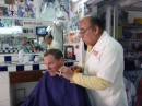 John loves his $50ps haircuts.  Check out the straight razor for the edges!