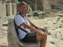 Jan seated on a stone carved seat at top of the Miletus theatre