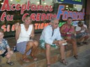 "A cheep cruisers dinner. Enjoying some bacon rapped hot dogs from the ""hot dog guy"" in La Paz.  10 pesos per hot dog...."