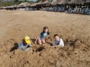 Zach, Kaitlyn and foster enjoy the sand.