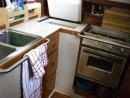 Our old fridge died - the only thing I kept were the handles which became new grab rails in the galley.
