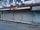 Sunday afternoon, downtown.  Just about every one is closed.  This is the second largest grocery store in Kudat.