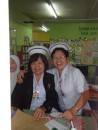 The nurse on the right is the one one that checked Tracy in for a checkup.  Nice bunch of happy women.