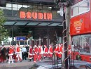 The Santas in front of Boudin sourdough bakery.