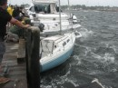 The small sailboat that hit the big powerboat that was docked outside the marina bulkhead