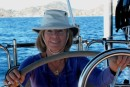 Woman at the Helm.. Leaving hectic Cabo San Lucas behind with a big smile.