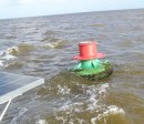 This is the Preferred Channel buoy located in the vicinity of 10-03.83N 062-09.17W. Since the topmost band is red, it should be honored as any lateral red buoy in IALA B region - when returning from seaward keep the buoy on your starboard hand.