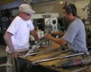 Keith the welding foreman and Tom discuss a stanchion repair.