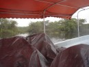 On our way to Lamanai...This is the way they offer to keep you dry at 15 knots in the rain