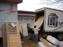 "The guys ""quickly"" unload 12 windows and 14 doors"