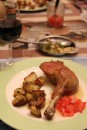 French Home cooking: confit duck leg with roast potatoes and tomato salsa