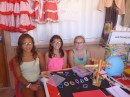 Anne and her friends selling their elastic bracelets at the school market.